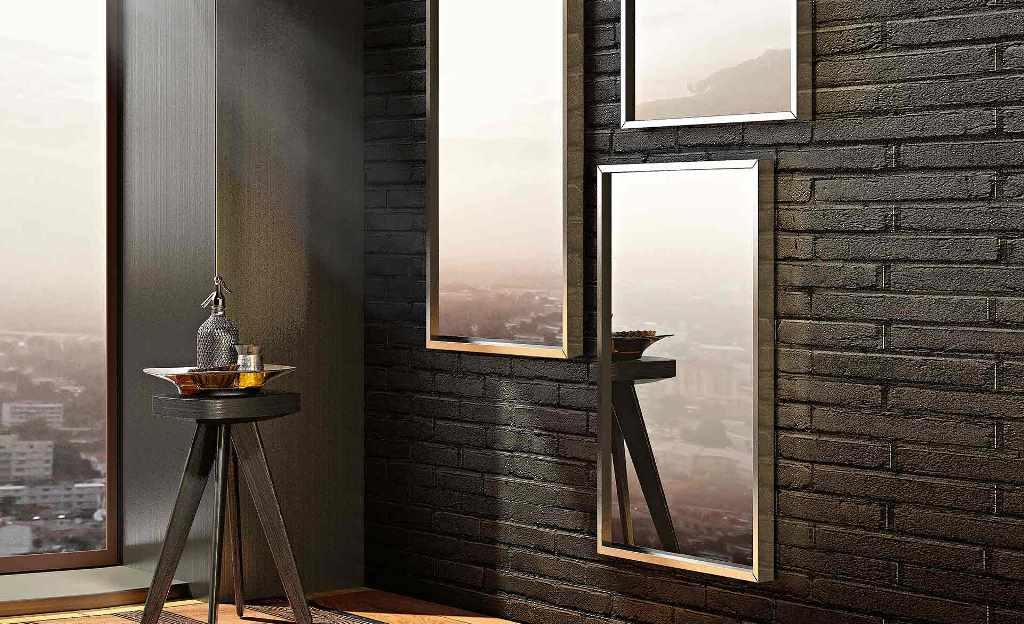Specchio Altea Riflessi con cornice in alluminio.