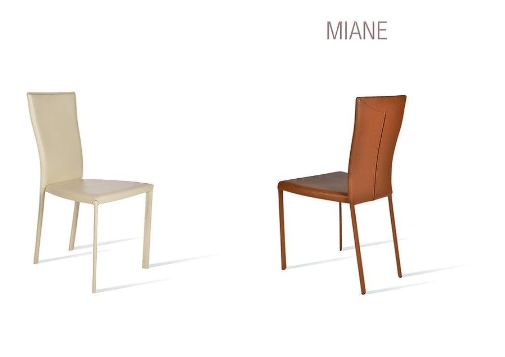 Sedia Miane con schienale alto e rivestimento a scelta tra pelle, ecopelle e cuoio.
