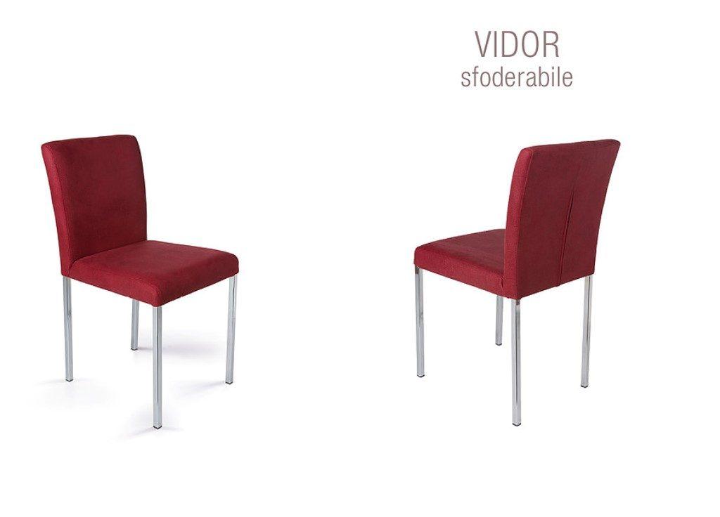 Sedia Vidor con gambe cromate e seduta con rivestimento a scelta tra pelle, ecopelle, econabuk e cuoio.